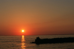 Couple enjoying Lake Pontchatarian sunset