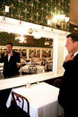 Waiter straightens his tie before opening of Galatoire's