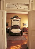 Antique bed in historic Beauregard Keyes house in New Orleans