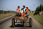 CUBA. Cuban family in a cart going home on the road in the outskirts of the village of Playa Giron. Matanzas province.