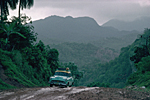 CUBA, Guantanamo province. On the road from Baracoa to Moa old American car from the 50s on mountainous dirt road in the forest.
