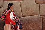 PERU. Quechua Indian selling traditional textiles in front of Inca Roca palace in Hatunrumiyoc street in Cusco.
