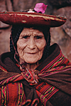 "PERU, Andes, Cusco province. The oldest Quechua lady of the village of Chinchero wearing the traditional hat of her village and an old ""manta"" around her shoulders."