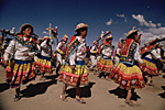 BOLIVIA, Andes. Near Potosi Quechua Indian women dancing during the festival of Santa Rosa de Lima, first catholic saint of the American continent. It is celebrated the last week of August.