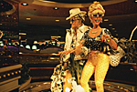 USA, Nevada, Las Vegas : in the hotel casino Harrahs on the Strip, couple covered with US$ dollar bills.