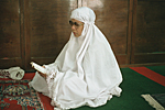 THAILAND, Bangkok : Thai Muslim praying and reading the Coran during Friday prayer inside a mosque.