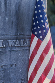 American Flag Draped on an Old Gravestone