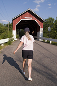 Woman walking for exercise in New Hampshire.