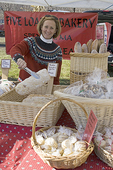 Baker Serves Up Some Fresh Baked Bread at a Country fair