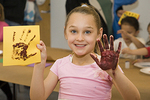 Young Girl Makes a Hand Print