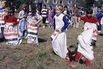 Children Compete in an Old Fashioned Sack Race