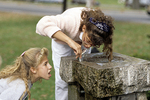 Girls at a Drinking Fountain