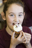 Girl Eating a Cupcake