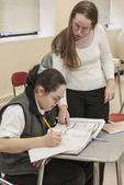 High School Teacher with a Student