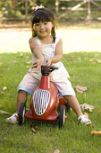 Girl Playing on a Toy Car