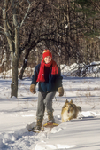 Woman Snowshoeing with her collie