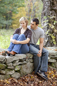 Couple Sitting on a Stone Wall