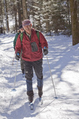 Man in Red Jacket Cross Country Skiing