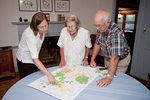 Family Members Looking at Map of Their Property