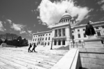 Two People Walk Down the Capitol Steps