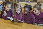 Four Girls Reading