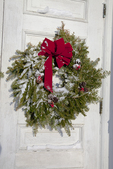 Red Ribbon on the Snow Covered Wreath