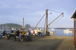 People Enjoying Lobster Dinners on Five Islands Wharf
