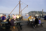 People Enjoying Lobster Dinners on Five Islands Wharf #2