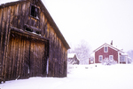 Red Farm House and Barn In A Snow Storm