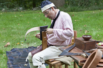 Colonial Reenactor Working with Leather