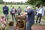 Farmer Pressing Apples to Make Cider At Minuteman National Park
