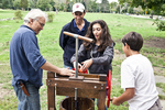 Farmer Shows Visitors To The MNP How to Press Apples To Make Cider