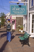 Man Walking By Shops in Boothbay Harbor