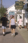 Couple Walking Down the Sidewalk in Boothbay Harbor, Maine