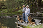 Older Couple with Their Pet German Shepherds