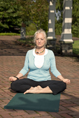 Woman seated doing yoga