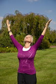 Woman standing arms outstretched in a yoga pose