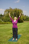 Woman standing doing yoga