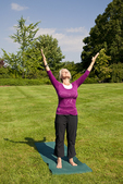 Woman looking skyward arms outstretched