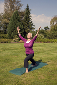 Woman standing holding a yoga pose #2