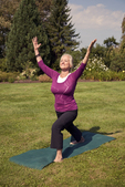 Woman standing holding a yoga pose #3
