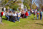 People sitting and eating at the country fair