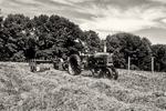 Farmer baling hay in Massachusetts with his old Farmall tractor