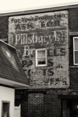 Old signs on a building in Gardner, MA
