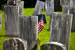 Old cemetery and an American flag in Buckland, MA