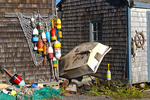 A dinghy lays up against a fishing shack in Rockport, Massachusetts
