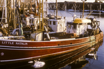 Fishing boats tied up the dock in Provincetown Harbor, MA