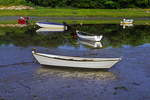 Row boats stranded at low tide on the Maine coast.