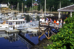 Tourists to Ogunquit, ME wait to board a tour boat in Ogunquit Harbor. 