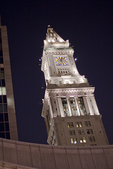Custom House Tower lit up at night in Boston, MA.